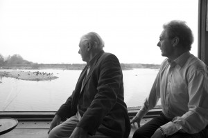 Sir David Attenborough and Martin Spray, in the window of Sir Peter Scott's studio at Slimbridge