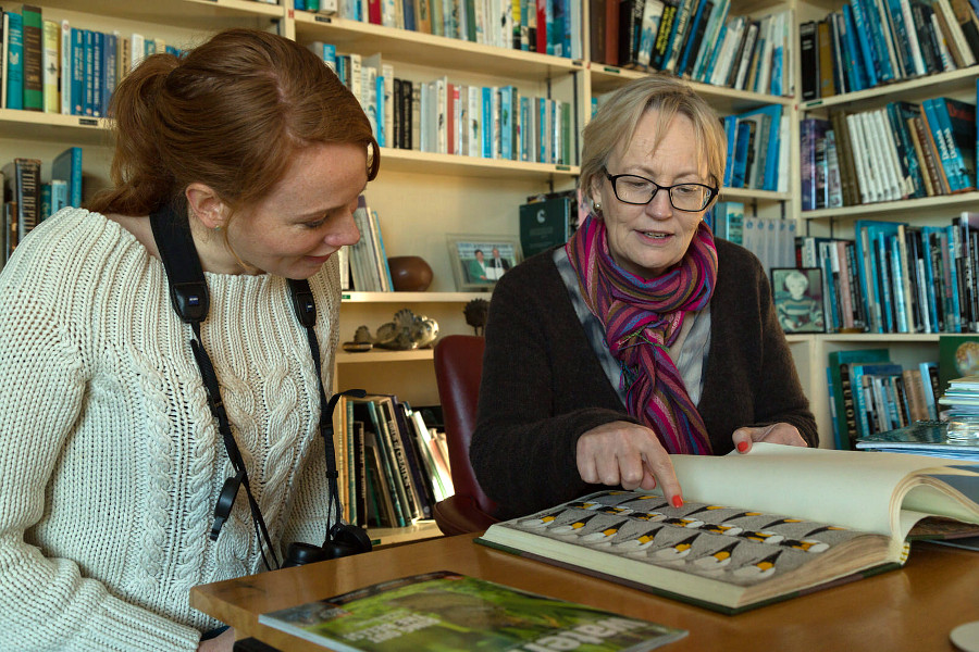 WWT researcher Julia Newth shows Mrs Girling some of the original drawings from WWT's long running Bewick's swan study (c) Sam Stafford WWT