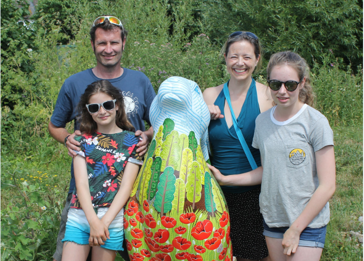 Sarah Vonthron-Laver with family and the hare she designed as part of the Cotswolds AONB Hare Trail - 'Haring Through the Seasons'