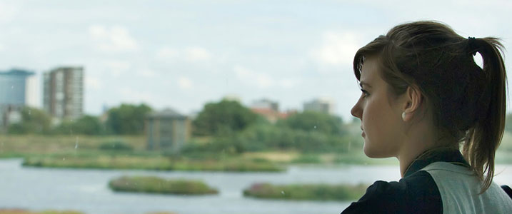 A woman looking out over a WWT wetland centre